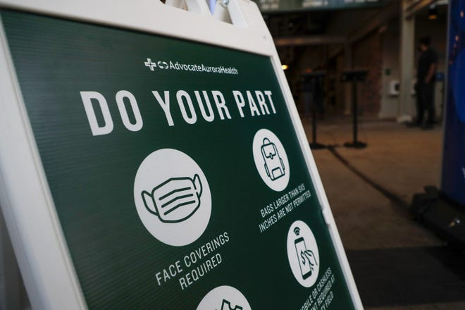 Signage is placed throughout Wrigley Field to remind fans of key measures they must take, including: stay home if your are sick, maintain social distance and everyone over 2 years old must wear a mask.