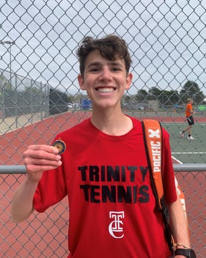 Trinity Catholic's Anthony Clennan wins the No. 1's singles division at the Hutchinson Salthawks Tennis Invitational.