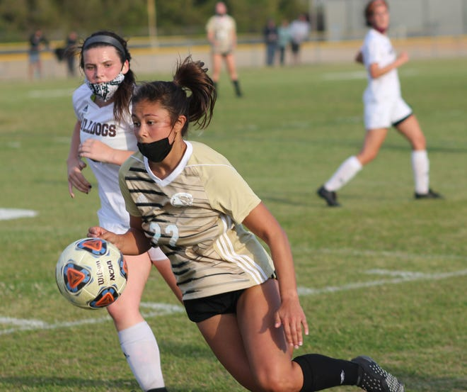 Croatan's Cora Taylor plays the ball during the Cougars' 2-1 win over Dixon last Wednesday. [Chris Miller / The Daily News]