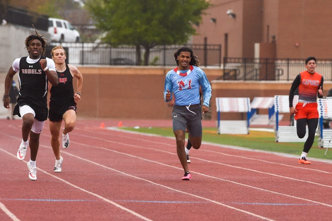 Monterey's MJ Singleton (center) runs against Tascosa's Major Everhart (far left) in the 200 meter dash during the Class 5A area track meet on Thursday April 15, 2021 at PlainsCapital Park at Lowrey Field in Lubbock, Texas.