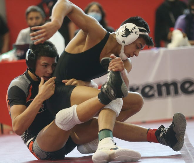 Lubbock High's Zach Casias (right) competes in a 120-pound division match Friday, April 16, 20201, against Caprock's Richard Davila during the Region I-5A Tournament at Bel Air High School in El Paso.