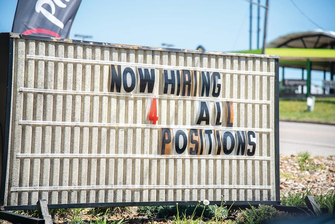 """A sign outside of Pizza Hut in Eldon reads """"Now Hiring 4 All Positions."""""""