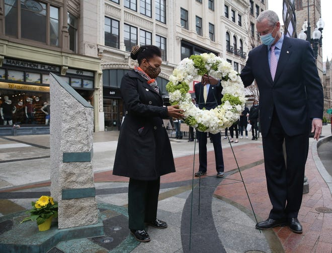 Gov. Charlie Baker and Boston acting Mayor Kim Janey  place a wreath at the site of the Boston Marathon Bombing Memorial on Thursday, the eighth anniversary of the Boston Marathon bombings.