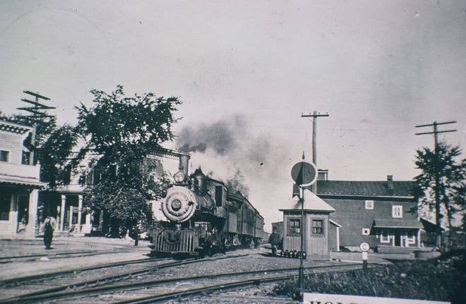 A Peanut Line train arriving in Holcomb from the west in the early 1900s. In a few minutes, this train would be traversing the town of Canandaigua.