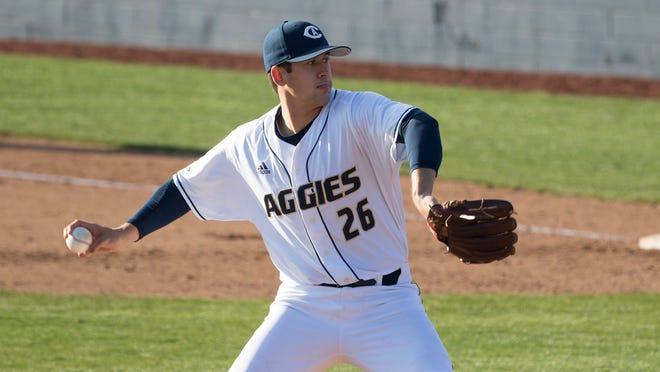 Kaden Riccomini throws a pitch for the UC Davis Aggies.