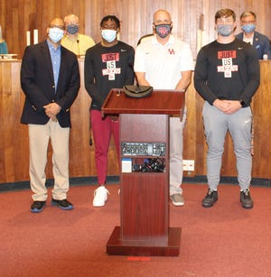 Oak Ridge City Council member Derrick Hammond, pictured at left, and the rest of Council honored the Oak Ridge Wildcats basketball team with a resolution Monday, making April 12, 2021 Oak Ridge High School Basketball Day. Pictured from left to right are Hammond, senior Johnathan Stewart, Coach Aaron Green and senior Nick Dallas.