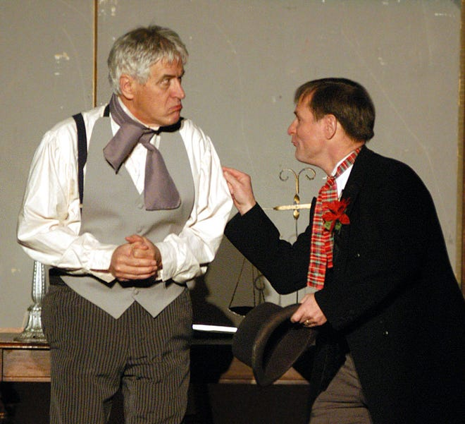 Richard Enders (left) portrays Scrooge with Jim Revenaugh as his nephew Fred in this 2005 file photo of a performance of Scrooge, the musical by the Utica Players at the Stanley Center for the Arts.  Enders, a Clinton attorney, died Thursday, April 15, 2021 at the age of 79.