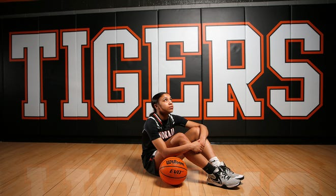 Kelbie Washington poses for a photograph at Norman High School in Norman, Okla., Wednesday, April 14, 2021.