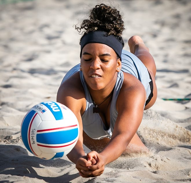 West Port's Mileydie Maysonet dives for the save in the final set in the Girls Beach Volleyball Regional Finals at the Ocala Sportsplex on April 15.