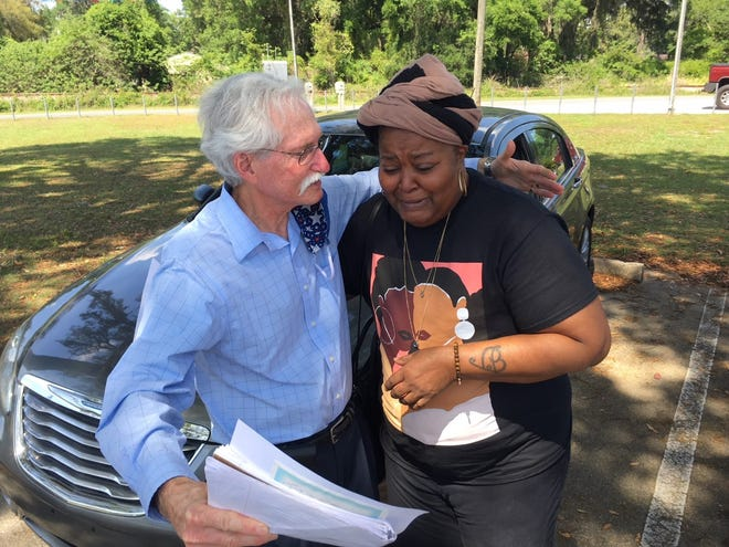 Belinda Harvey is overcome with emotion as she receives a donated car. Community leader Scott Hackmyer helped arrange the assistance for Harvey.