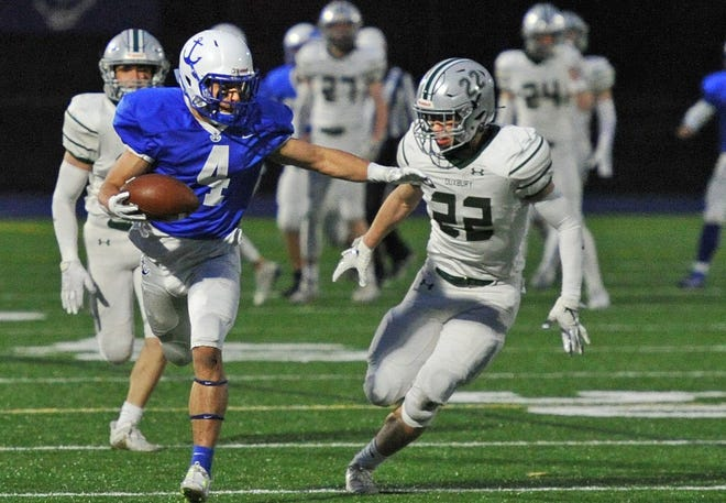 Scituate receiver Patrick DeMatteo, left, fends off Duxbury's Campbell Pang during high school football action at Scituate High School, Thursday, April 15, 2021.