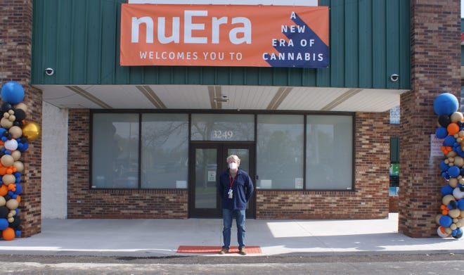 NuEra principal officer Keith McGinnis welcomes patrons to the newly-opened adult-use dispensary in Pekin.
