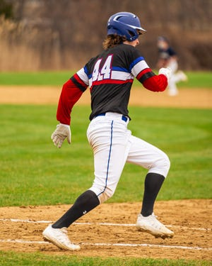 Winnacunnet senior Hayes Waddell rounds first base on his RBI double in Thursday's 6-1 win over St. Thomas Aquinas.