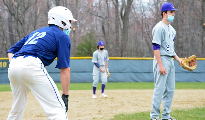 York's Joe Neal takes a lead off third base as Marshwood's Chase Stanley gets ready for a pitch to be thrown in the third inning of Thursday's baseball game at York High School.