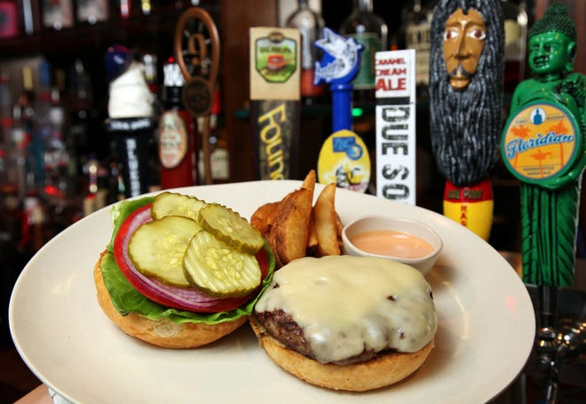Flame-broiled cheeseburgers served with pink 'Rock n Roll' sauce at Double Roads Tavern in Jupiter