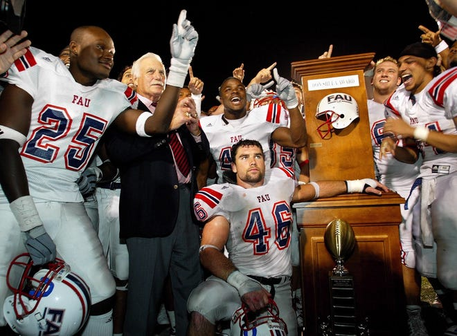 Then FAU coach Howard Schnellenberger is surrounded by his players as they accepted the Don Shula Award after defeating FIU in Miami during the 2003 season.