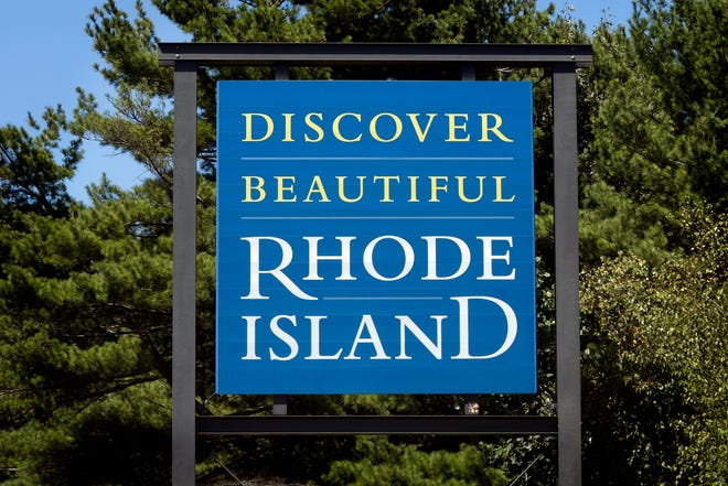 """A """"Discover Beautiful Rhode Island"""" sign at the Rhode Island/Massachusetts border on Route 195 west."""