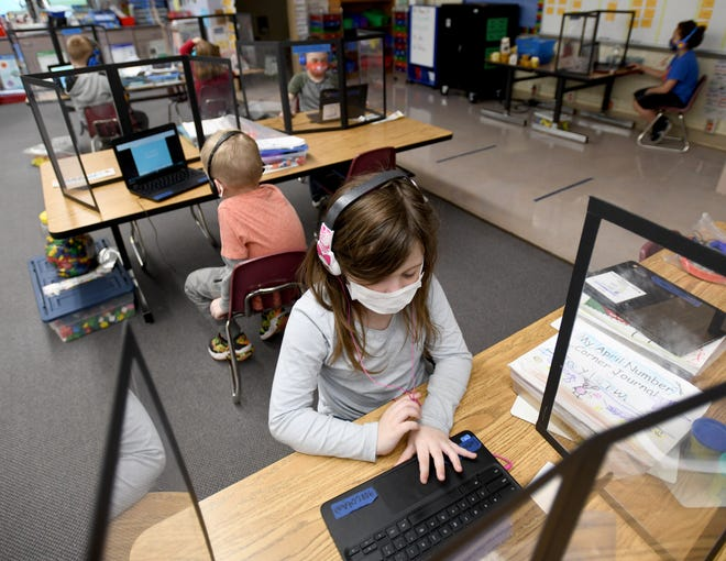 Taylor Weibush works along with her kindergarten class at B.L. Miller Elementary School as Sebring Local School District tries to pass an income tax renewal levy. Friday, April 16, 2021.