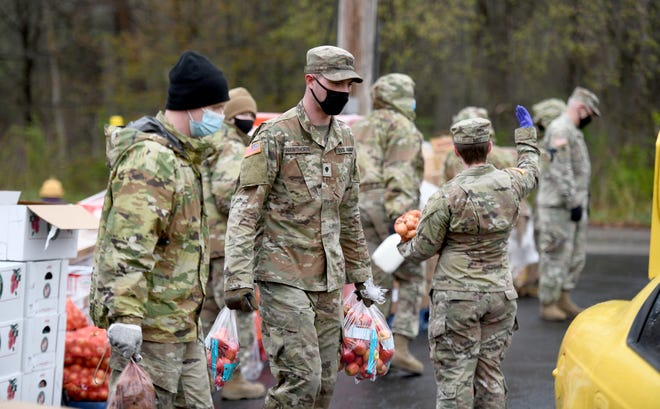 Members of the Ohio National Guard work Friday with Second Harvest Food Bank of the Mahoning Valley during a Traveling Food Pantry at B.L. Miller Elementary in Sebring. Also helping out was the Village of Sebring and Sebring Local Schools.