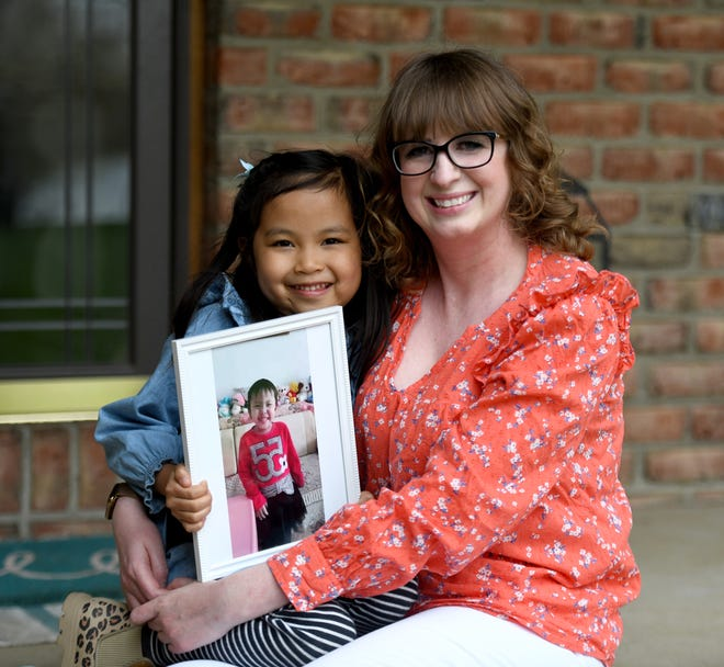 Jacquelynn Shank of Lake Township, shown with daughter Summer, 6, is waiting to finalize the adoption of 4-year-old daughter June from China. She hasn't been able to finalize the adoption process because of the COVID-19 pandemic.