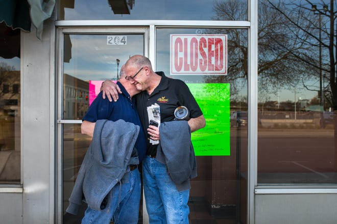 Brothers and lifelong Palace Shoe Repair coworkers Dave, left, and Tom Giamalva tearfully embrace after locking the shop's doors for the last time Friday, April 16, 2021. The Rockford shop had been in business for 95 years.