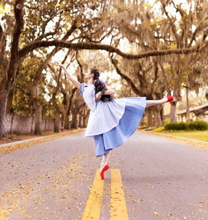 """Young Dorothy Gale, played by local high school student Jolynne Waldner, is shown on the famous Magnolia Avenue in St. Augustine. Waldner plays Dorothy in Saint Augustine Ballet's production of """"The Wizard of Oz,"""" on stage May 22 for two performances in Lewis Auditorium atFlaglerCollege."""