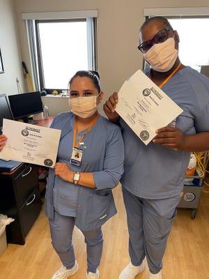 "Sarasota Memorial Hospital employees Karen Tapia and Belinda Smith. ""SMH taught me that it's never too late to start a career,"" Tapia said."
