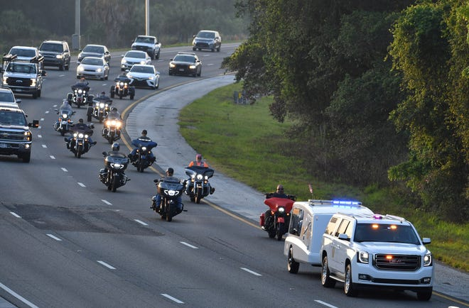 The funeral procession for WWII and Korean War veteran Wallace Taylor heads north on I-75 from Sarasota early Friday. Taylor, a U.S. Army veteran, outlived all of his relatives when he died in February at 96, but thanks to a handful of fellow veterans, he's being transported to his native Kentucky to great fanfare, with motorcycle escorts accompanying him across three days and six states.