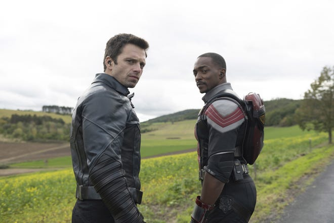 "Sebastian Stan as Winter Soldier/Bucky Barnes, left, and Anthony Mackie as Falcon/Sam Wilson in a scene from the Disney+ series ""Falcon and the Winter Soldier."""