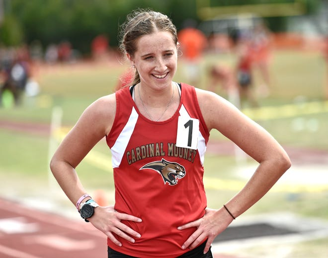 Cardinal Mooney's Rachel Jarrett wins the 3,200-meter run in a time of 12:33.37, during the Class 2A-District 12 track meet held at Booker High in Sarasota on Thursday.