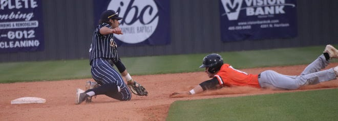 Shawnee shortstop Krew Taylor (left) prepares to place the tag on a Coweta baserunner after taking a throw from catcher Creed Muirhead during a recent game.