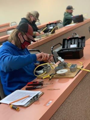 Strother student and FFA member Travis Woolsey works on a wiring project for the Electricity competition at the SSC FFA Interscholastic Contest on April 8. Wooley received a perfect score on his project.