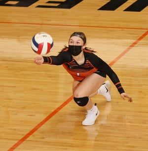 Rachel Brown keeps the ball alive with a dig in Kewanee's match Thursday against Newman Central Catholic.