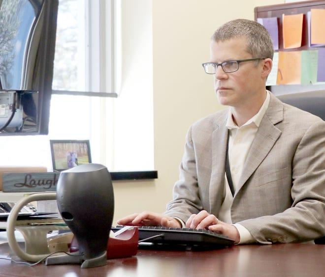 Art Ebert, superintendent at Sturgis Public Schools, works Wednesday at his office.