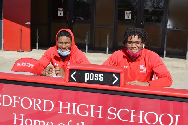 Bill and Billois Sousa will play football in the fall at East Coast Prep.