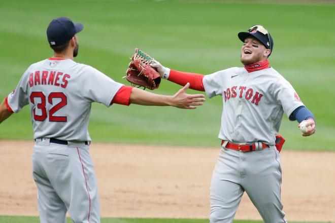 Boston Red Sox center fielder Alex Verdugo congratulates Boston Red Sox relief pitcher Matt Barnes after a win against the Minnesota Twins in Minneapolis.