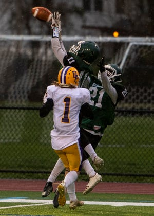 Burncoat's Kwasi Boakye catches a pass during a game against Bay Path on Thursday, April 15, 2021.