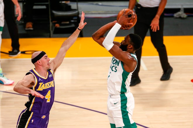 Boston Celtics' Jaylen Brown shoots over Los Angeles Lakers' Alex Caruso (4) during the first half of Thursday's game.