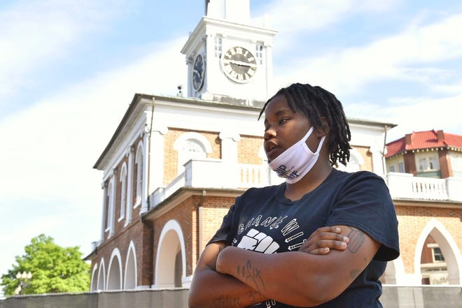 Myah Warren, a community activist, stands in front of the Market House in downtown Fayetteville late Friday afternoon.