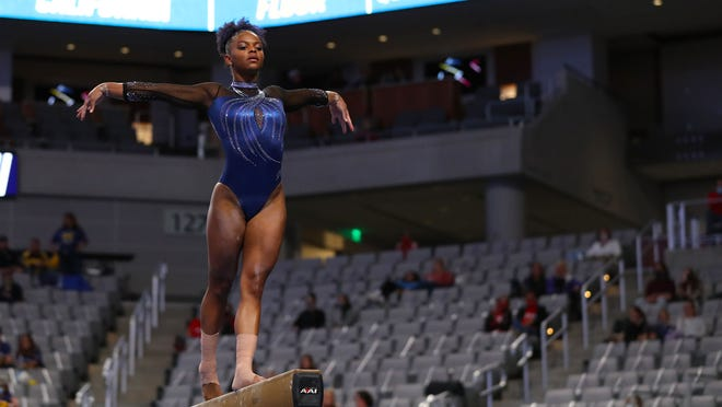 Florida's Trinity Thomas performs on the beam in Friday's NCAA Championships semifinal in Fort Worth, Texas.