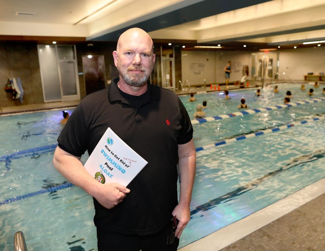 """Rudy Stankowski, the author of """"How to Get Rid of and Prevent Swimming Pool Algae,"""" at the Gainesville Health and Fitness pool that he maintains, at the health facility in Gainesville Friday."""