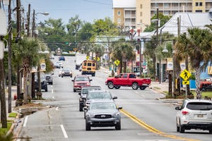 Traffic moves along Beck Avenue in downtown St. Andrews. Consultants presented a study last week that recommended options to increase parking in the neighborhood.