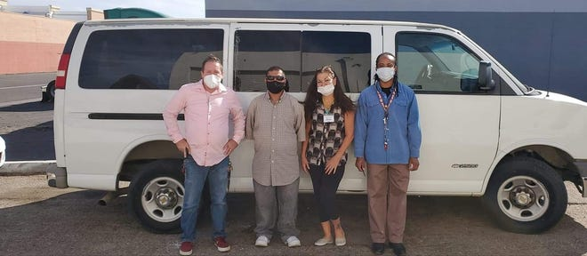 High Desert Homeless Services officials pose with the nonprofit's 2003 Chevrolet Express 2500 passenger van in an undated photo.