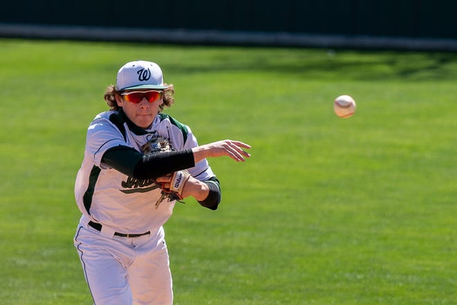 Waxahachie senior Casey Kelly (14) throws to first during a home game last month. Kelly pitched an eight-inning complete game for the win as the Indians beat Duncanville, 4-2, in extra innings on Tuesday night in Duncanville.