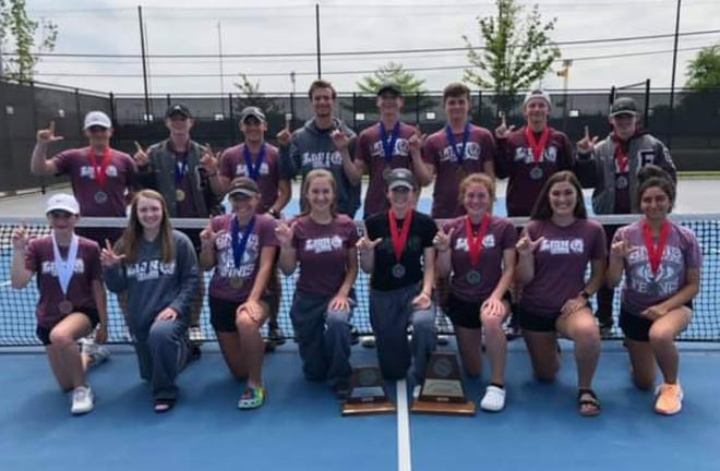The Ennis High School tennis team displays their wares after competing in the District 14-5A tournament in Midlothian. The boys won the district title and the girls were runners-up.