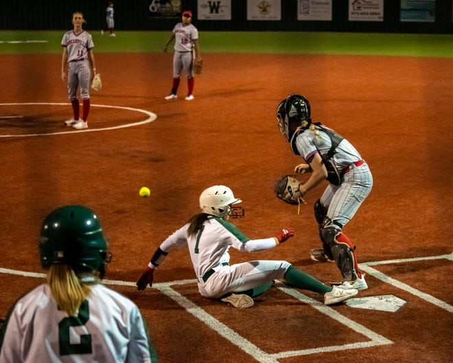 Waxahachie sophomore Kennedi Massey (7) slides into home safely against Duncanville in the two teams' first meeting at the Midkiff Athletic Complex. The Lady Indians took a 12-2 run-rule win on Tuesday at Duncanville to move closer to clinching playoffs.