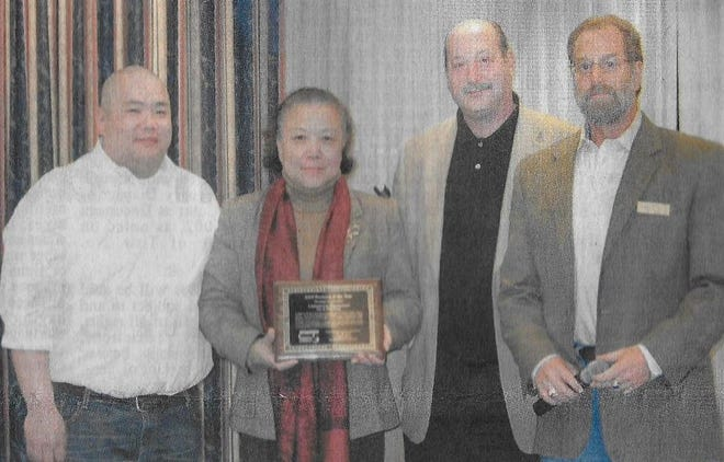 The Stoughton and Randolph chambers of commerce have merged, and added nearby towns such as Holbrook and Avon. In this newspaper clipping, (from left) Henry and Lisa Wong of Chinatown hold their 2010 Business of the Year Award presented by then Stoughton Chamber of Commerce Chairman of the Board Rick Kaplan and Vice Chair Mark Snyder.