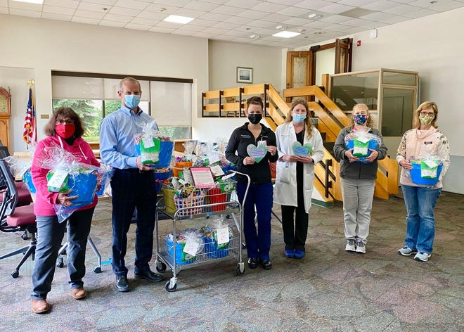 Members of the Marlborough Junior Woman's Club recently delivered 30 baskets of snacks and 150 homemade cards to the staff of UMass Memorial Marlborough Hospital. Pictured, from left: Georgina Chamberlain, John Kelly, Annmarie McKinley, Stephanie MInardi, Nomi Monro and Kyla LoConti.