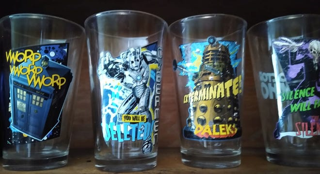"""A set of collectible """"Doctor Who"""" glasses on a shelf in a Worcester Magazine editor's home."""