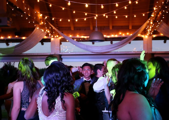 FILE — Bremerton High students dance the night away during the 2016 prom at Trophy Lake Golf & Casting Club in Port Orchard. High schools students are welcoming the chance to celebrate prom this spring after COVID-19 canceled plans in 2020.